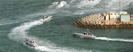 Iranian navy boats attend a drill in the sea of Oman, on Friday, Dec. 30, 2011. (AP/IIPA, Ali Mohammadi)