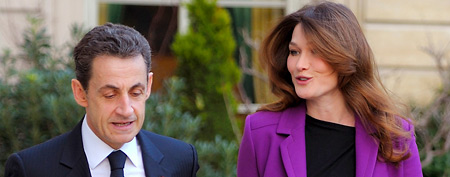 France's President Nicolas Sarkozy and First Lady Carla Bruni-Sarkozy walk in the gardens of the Elysee Palace in Paris, on Thursday, Jan. 26, 2012.(AP Photo/Philippe Wojazer, pool)