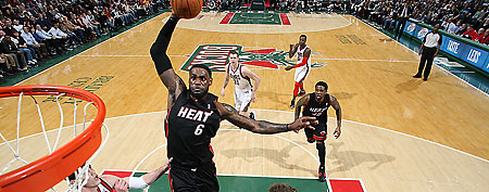 LeBron James #6 of the Miami Heat dunks against (L-R) Ersan Ilyasova #7 and Mike Dunleavy #17 of the Milwaukee Bucks on February 13, 2012 at the Bradley Center in Milwaukee, Wisconsin.  (Photo by Gary Dineen/NBAE via Getty Images)