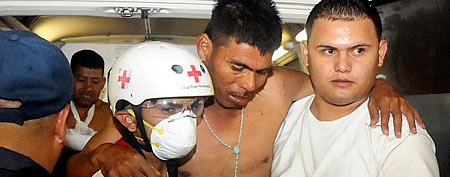 An injured inmate is carried as he arrives at the hospital after a fire broke out at the prison in Comayagua, Honduras (AP/Fernando Antonio)