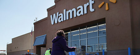 A woman enters a Walmart store in Valley Stream, New York (Getty Images)