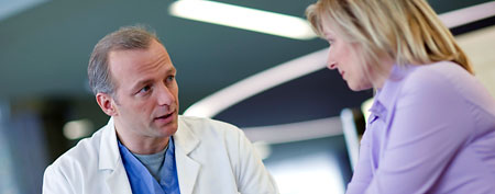 Doctor talking to patient. (Corbis)