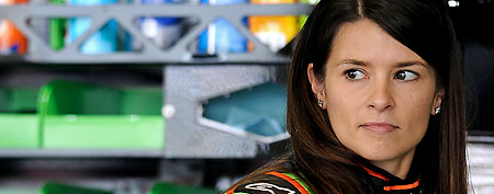 Danica Patrick, driver of the #10 GoDaddy.com Chevrolet, stands in the garage during practice for the NASCAR Sprint Cup Series Daytona 500 at Daytona International Speedway on February 18, 2012 in Daytona Beach, Florida. (Photo by Jared C. Tilton/Getty Images for NASCAR)