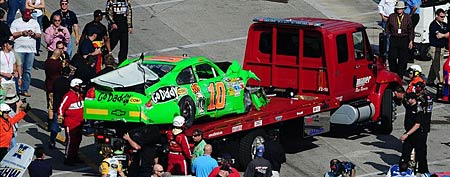 The crashed car of NASCAR Sprint Cup Series driver Danica Patrick (10) is taken to the garage by a tow truck after crashing on the last lap during race one of the Gatorade Duel at Daytona International Speedway. (Mark J. Rebilas-US PRESSWIRE)
