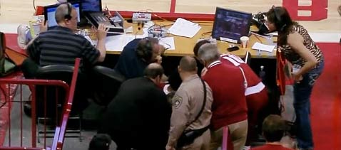 Onlookers help Jimmy Dykes to his feet after he's slammed into by Alabama's Levi Randolph (Y! Sports screengrab)