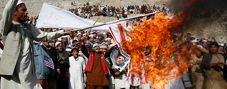 Afghans burn an Obama effigy. (AP)