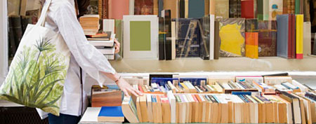 Woman browsing used books (Thinkstock)