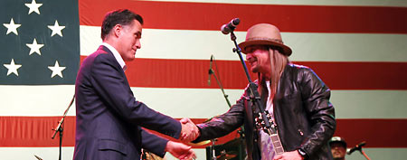 Republican presidential candidate, former Massachusetts Gov. Mitt Romney shakes hands with musician Kid Rock after he performed a song at a campaign rally in Royal Oak, Mich., Monday, Feb. 27, 2012. (AP Photo/Gerald Herbert)