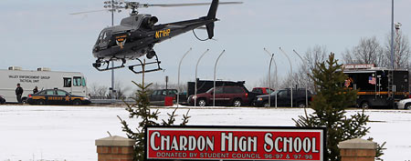 An Ohio State Highway patrol helicopter leaves Chardon High School Monday, Feb. 27, 2012 (AP/Tony Dejak)
