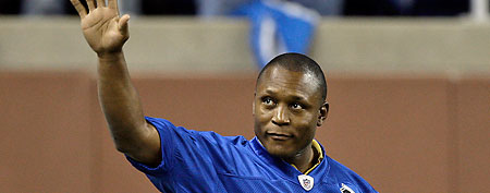 Former Detroit Lions running back Barry Sanders waves to the crowd as the Detroit Lions 75th season all-time team was introduced at halftime of the Jacksonville Jaguars-Detroit Lions NFL football game in Detroit, Sunday, Nov. 9, 2008. (AP Photo/Paul Sancya)