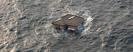 This file photo taken March 13, 2011 shows a Japanese home adrift in the Pacific Ocean, days after a massive earthquake and the ensuing tsunami hit Japan's east coast. (AP Photo/U.S. Navy, Dylan McCord)