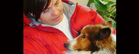 Barbara Bagley and her Shetland sheepdog Dooley after the two were reunited (AP/Shannon Sustacha)
