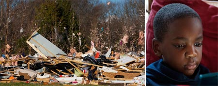 Debris is seen from the Stevens' home that was demolished by a twister in Charlotte, NC./ Jamal Stevens, 7, plays a video game at his grandparent's home, March 4, 2012.  (REUTERS/Chris Keane)