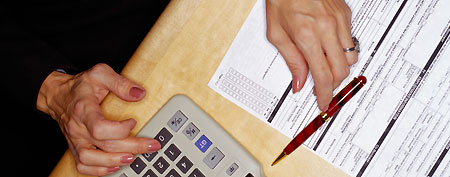 Senior citizen fills out a tax form. (ThinkStock)