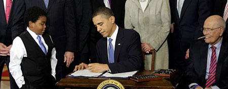 President Barack Obama signs the Affordable Care Act in 2010. (Scott Applewhite/AP)