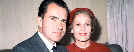 Richard Nixon, left, and his wife Pat pose for photos while campaigning at Rockefeller Center in New York in 1960. (AP)