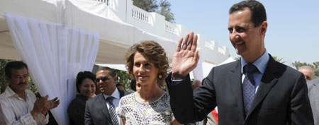 Syrian President Bashar Assad and his wife Asma Assad, arrive to visit a technology plant Tuesday July, 13, 2010 in Tunis. President Assad is on a two-day visit to Tunisia. (AP Photo/Hassene Dridi)