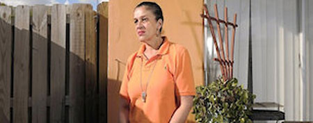 Janice Doble wears the orange shirt that got her fired (Michael Laughlin/Sun Sentinel)