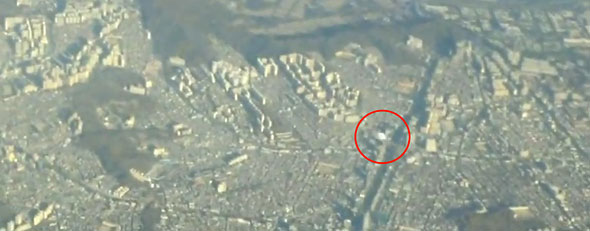 A UFO seen outside a passenger airline flying over South Korea (Yahoo!)