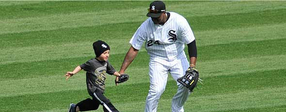 Dayan Viciedo #24 of the Chicago White Sox catches a child running on the field before the start of the seventh inning during a game between the Chicago White Sox and the Baltimore Orioles on April 19, 2012 at U.S. Cellular Field in Chicago, Illinois. A security guard brought the child back to his family. (Photo by David Banks/Getty Images)