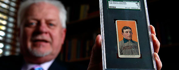 A rare Honus Wager baseball card fetches a huge sum at auction. (AP Photo/Jeff Roberson, File)