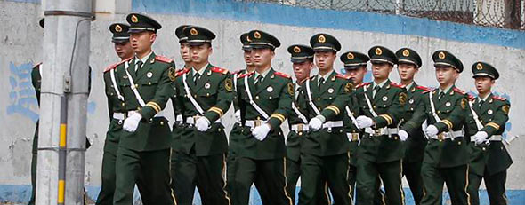 Paramilitary police officers patrol near the U.S. embassy in Beijing April 29, 2012. (Reuters/Jason Lee)