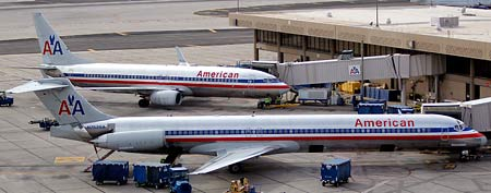 American Airlines' jets sit at the gate Tuesday, Nov. 29, 2011, at Sky Harbor International Airport in Phoenix. (AP Photo/Matt York)