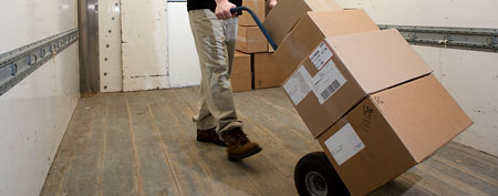 Moving boxes on hand truck (Thinkstock)