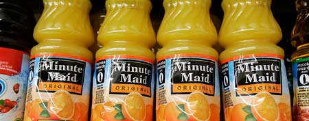 Minute Maid orange juice is on display at JJ&F Market in Palo Alto, Calif., Monday, Feb. 9, 2009. Minute Maid parent company is Coca-Cola Company. (AP Photo/Paul Sakuma)