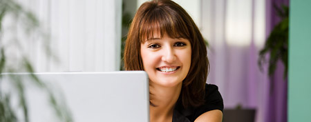 Woman working on laptop (Thinkstock)