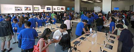 Customers attend the grand opening of an Apple retail store on July 30, 2011 in Glendale, California. (David Livingston/Getty Images)