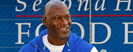 Michael Jordan smiles, Monday, Feb. 20, 2012, in Charlotte, N.C. (AP Photo/Bob Leverone)