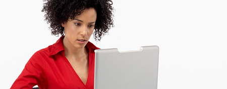 Woman looking online for job postings (Thinkstock)