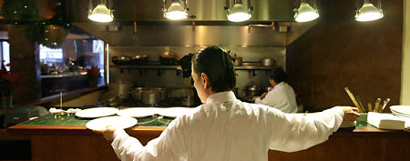 Workers prepare for lunch in the kitchen at the Palio D'Asti restaurant in San Francisco on Wednesday Dec. 7, 2011. (AP Photo/Eric Risberg)
