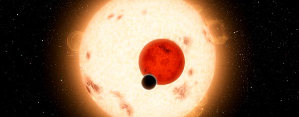 In this handout digital illustration released on September 15, 2011 by NASA, the newly-discovered gaseous planet Kepler-16b orbits its two stars, the larger a K dwarf and the smaller a red dwarf. (Photo by NASA/JPL-Caltech/R. Hurt via Getty Images)