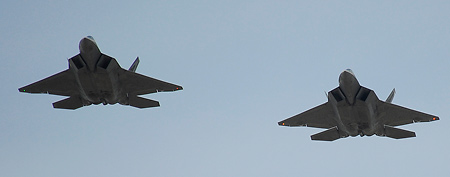 Two Lockheed Martin/Boeing F-22 Raptor's fly over the NASCAR Sprint Cup Series auto race before the green flag at Talladega Superspeedway Sunday, Oct. 23, 2011, in Talladega, Ala. (AP Photo/Dan Lighton)