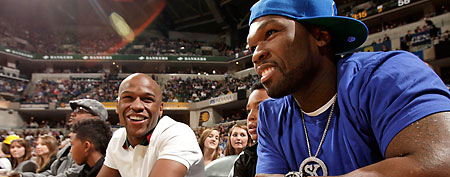 Boxer Floyd Mayweather Jr. (L) and musician Curtis '50 Cent' Jackson (R) talk during the game between the Orlando Magic and Indiana Pacers on February 4, 2012 at Bankers Life Fieldhouse in Indianapolis, Indiana. NOTE TO USER: User expressly acknowledges and agrees that, by downloading and or using this Photograph, user is consenting to the terms and condition of the Getty Images License Agreement. Mandatory Copyright Notice: 2012 NBAE (Photo by Ron Hoskins/NBAE via Getty Images)