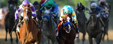 I'll Have Another ridden by Mario Gutierrez (L) beats Bodemeister ridden by Mike E. Smith at the finish line to win the 137th running of the Preakness Stakes at Pimlico Race Course on May 19, 2012 in Baltimore, Maryland. (Photo by Patrick Smith/Getty Images)