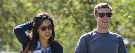 Mark Zuckerberg, president and CEO of Facebook, walks to morning sessions with his girlfriend Priscilla Chan during the 2011 Allen and Co. Sun Valley Conference, Saturday, July 9, 2011, in Sun Valley, Idaho (AP Photo/Julie Jacobson)