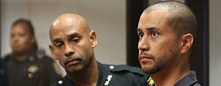 George Zimmerman, right, stands next to a Seminole County Deputy during a court hearing in Sanford, Fla. Zimmerman has been charged with second-degree murder in the shooting death of the 17-year-old Trayvon Martin.  (AP Photo/Gary W. Green, Orlando Sentinel, Pool)