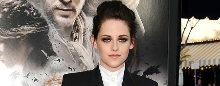 Kristen Stewart pairs flirty mini-skirt with blazer. (Jason LaVeris/FilmMagic)