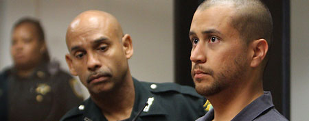 George Zimmerman, right, stands next to a Seminole County Deputy during a court hearing in Sanford, Fla. (AP Photo)