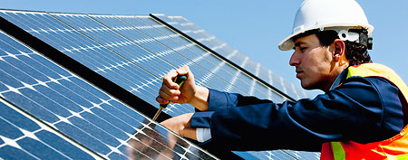 The decade's fastest-growing industries. In this photo: A technician installing solar panels (Corbis)