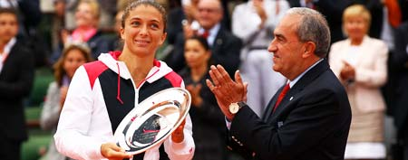 President of the French Tennis Federation Jean Gachassin applauds as Sara Errani of Italy poses with the runners up trophy after the women's singles final against Maria Sharapova of Russia during day 14 of the French Open at Roland Garros on June 9, 2012 in Paris, France. (Photo by Clive Brunskill/Getty Images)