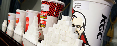 Various size cups and sugar cubes are displayed at a news conference at New York's City Hall, Thursday, May 31, 2012. (AP Photo/Richard Drew)