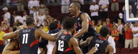 Team USA, with Kobe Bryant at top right, celebrates following their win over Spain in their men's gold medal basketball game at the Beijing 2008 Olympics in Beijing in 2008. (AP Photo/Eric Gay)