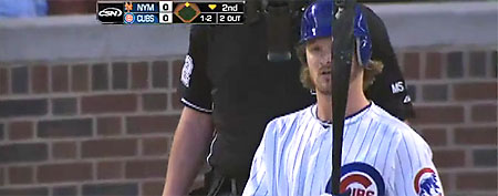 Chicago Cubs pitcher Travis Wood apparently had no idea he was stepping to the plate with a hilarious mistake on his head. (Screen grab courtesy of Yahoo! Sports Blogs)