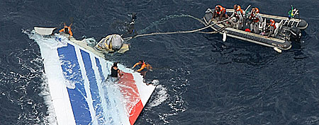Brazil's Navy sailors recover debris from the missing Air France Flight 447 in the Atlantic Ocean. (AP Photo/Brazil's Air Force)