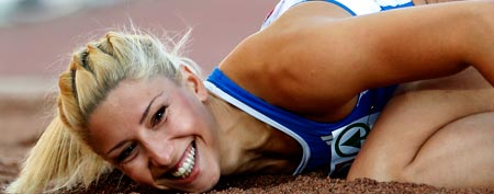 Greece's Voula Papachristou lands in the sand after her jump at the Women's Triple Jump final at the European Athletics Championships in Helsinki, Finland. (AP Photo/Matt Dunham, file)