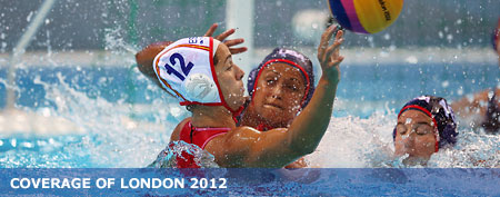 Brenda Villa of the U.S. blocks Laura Lopez Ventos of Spain on Day 5 of the London 2012 Olympics. (Jeff J. Mitchell/Getty Images)